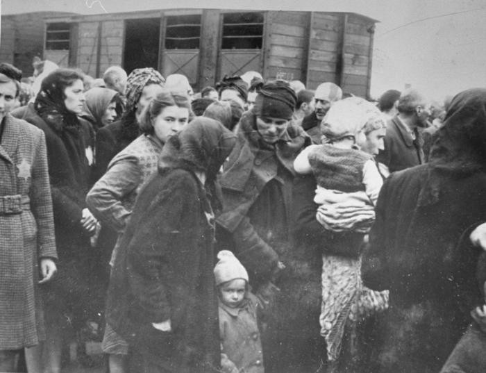 Jews from Subcarpathian Rus get off the deportation train and assemble on the ramp at Auschwitz-Birkenau. May 1944.