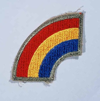"""Insignia of the 42nd Infantry Division. The nickname of the 42nd Infantry Division, the """"Rainbow"""" division, reflects the composition ... [LCID: n05637]"""