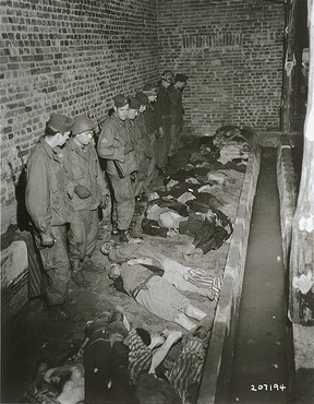 "<p>Troops of the American <a href=""/narrative/7977"">82nd Airborne Division</a> view bodies of inmates at <a href=""/narrative/7988"">Wöbbelin</a>, a subcamp of the Neuengamme concentration camp. Germany, May 6, 1945.</p>"