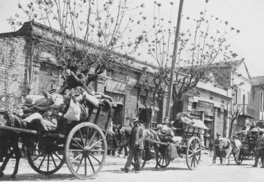 <p>Greek Jews from the provinces move into a designated ghetto area, previously the Baron de Hirsch quarter. Jews were concentrated in this western quarter, near the railway station, in preparation for impending deportations. Salonika, Greece, between November 1942 and March 1943.</p>