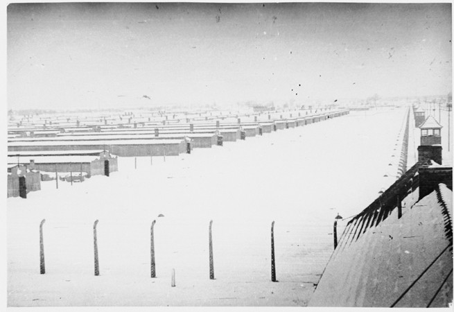 View of Auschwitz-Birkenau under a blanket of snow immediately after the liberation. [LCID: 58406]
