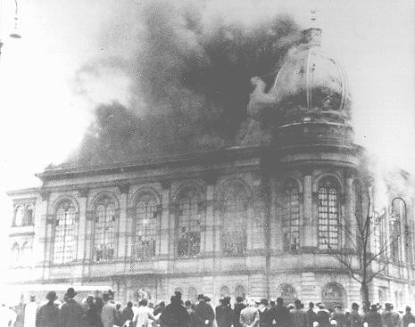 "The Boerneplatz synagogue in flames during Kristallnacht (the ""Night of Broken Glass""). [LCID: 64675]"