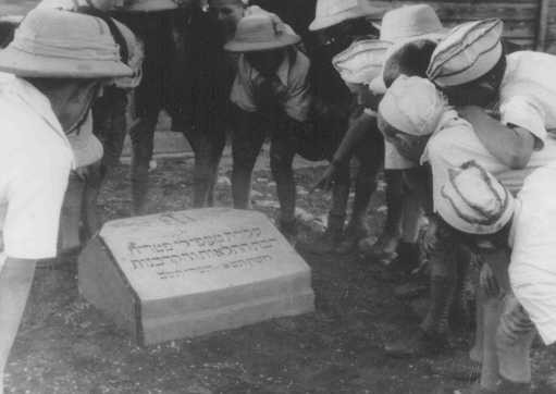 "<p>Polish Jewish refugee children known as the ""Tehran Children"" gather at a memorial stone dedicated to the Jewish refugees who died when the ""Patria"" (a ship bound for Palestine) sank in November 1940. Atlit, Palestine, 1943.</p>"