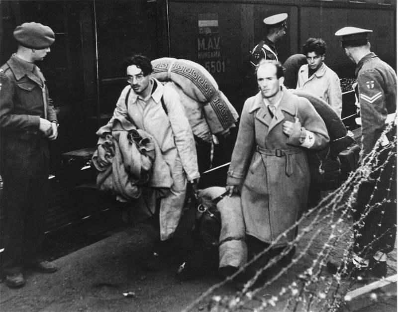 "<p>Jewish refugees, forcibly removed by British soldiers from the ship <a href=""/narrative/5265/en""><em>Exodus 1947</em></a>, arrive at Poppendorf displaced persons camp. Photograph taken by Henry Ries. Germany, September 8, 1947.</p>"