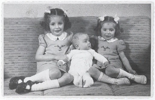 Eva, Alfred, and Leane Munzer. Infant Alfred survived in hiding; his sisters were discovered and killed in Auschwitz. [LCID: 94488]