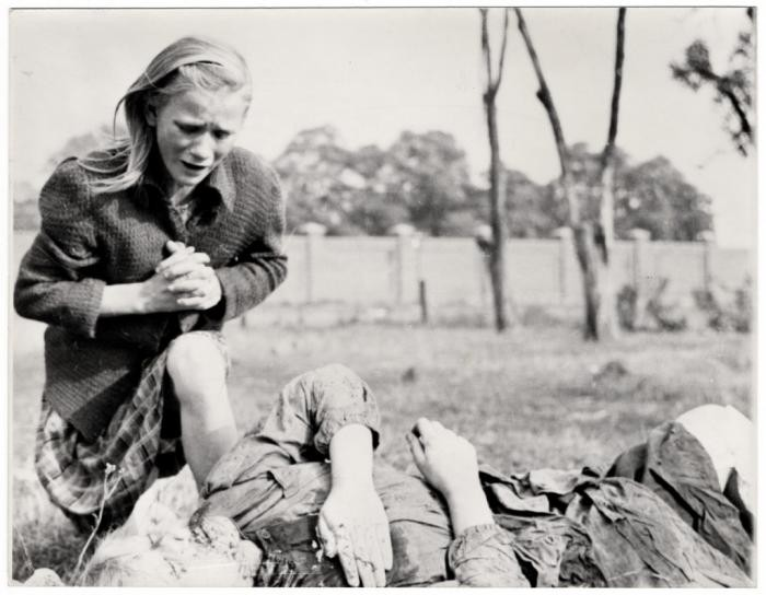 <p>A ten-year-old Polish girl, Kazimiera Mika, mourns the death of her older sister, who was killed in a field in Warsaw, Poland, during a German air raid. Photographed by US documentary filmmaker, Julien Bryan, on September 13, 1939.</p>