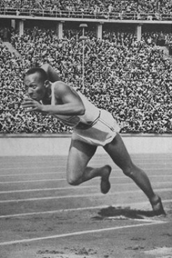 US runner Jesse Owens begins the 200-meter race in which he established a new Olympic record of 20.7 seconds. [LCID: 73517a]