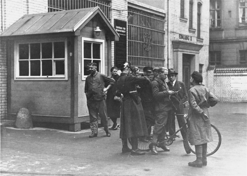 "<p>Police search a messenger at the entrance to the building where <em>Vorwaerts</em>, a Social-Democratic Party newspaper, was published. The building was subsequently occupied during the suppression of the political left wing in Germany that was carried out in response to the <a href=""/narrative/11461"">Reichstag Fire</a>. Berlin, Germany, March 3–4, 1933.</p>"