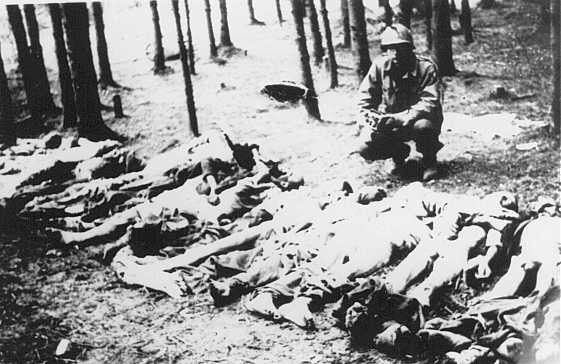 <p>A US soldier views corpses at the Gunskirchen camp, a subcamp of the Mauthausen concentration camp. Austria, after May 5, 1945.</p>