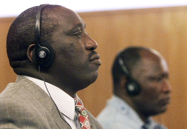 "<p>Singer Simon Bikindi sits at the International Criminal Tribunal for Rwanda during his trial for <a href=""/narrative/11398"">incitement to genocide</a>. Arusha, Tanzania, April 4, 2002.</p>"