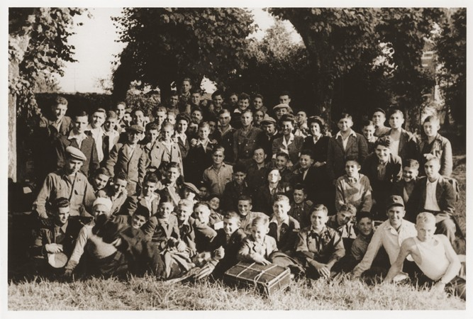 Group portrait of Jewish displaced youth at the OSE (Oeuvre de Secours aux Enfants) home for Orthodox Jewish children in Ambloy. [LCID: 28147]