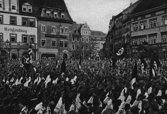 <p>A Nazi rally in market square, in the town center of historic Weimar where the constitution of the Weimar Republic was drafted in 1919. Germany, 1932.</p>