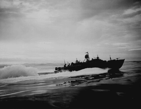 """<p>A US PT (Patrol Torpedo) boat off the coast of New Guinea, during an American counteroffensive against Japanese advances in the Solomon Islands in the eastern <a href=""""/narrative/2839/en"""">Pacific</a> Ocean, 1943.</p>"""