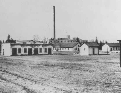 View of barracks and the ammunition factory in one of the first photos of Dachau concentration camp. [LCID: 55229]