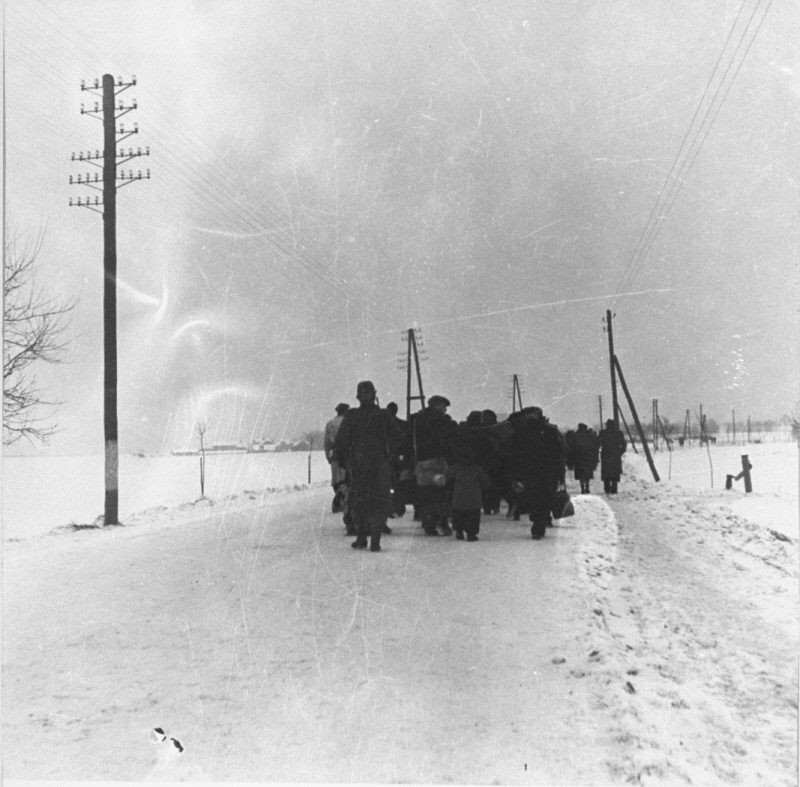 A transport of Jewish prisoners marches through the snow from the Bauschovitz train station to Theresienstadt. [LCID: 69720]