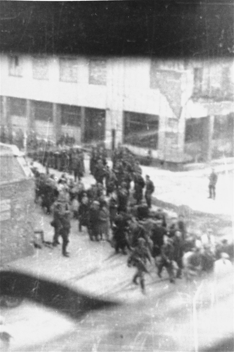 Deportation of Jews from the Warsaw ghetto during the uprising. [LCID: 80096]