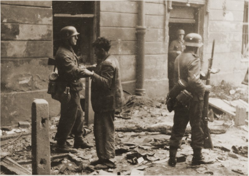 A captured Jewish resistance fighter who was forced out of his hidden bunker by German soldiers during the Warsaw ghetto uprising. [LCID: 73896]