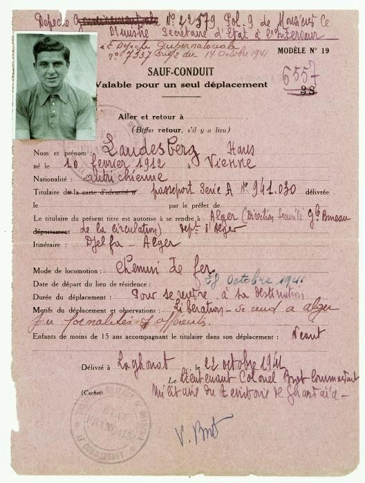 """<p>Safe conduct pass issued to Hans Landesberg in the Djelfa internment camp, releasing him to leave for Algiers. Djelfa, Algeria, January 26, 1943. Hans was born in Vienna, Austria, and went to medical school. After graduating, he left for Paris and joined a battalion of the International Brigade to fight in the Spanish Civil War. He returned to France in February 1939, only to be interned first in Argeles and then in Gurs. Some time after the French surrender to Nazi Germany in June 1940, Hans and other political prisoners were transported to the fortress of Mont-Louis near Andorra. Hans was then <span class=""""morecontent"""">deported on a freighter to Oran, Algeria. From Oran, he was sent first to Algiers. In 1941, Hans reached Djelfa, an internment camp where the prisoners were housed in tents. </span> He eventually received this safe conduct pass after writing to authorities that in 1939 he had begun the process to obtain an immigration visa to the United States.</p>"""