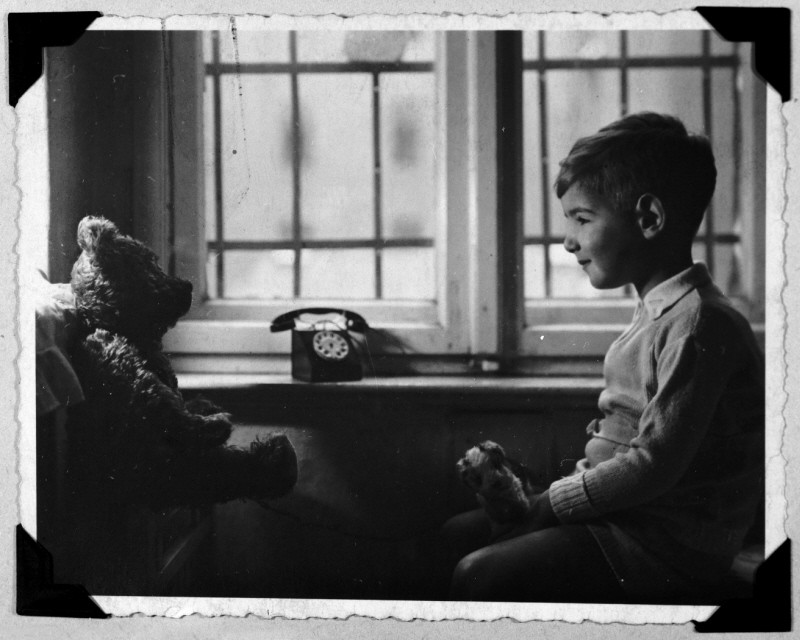 <p>Holocaust survivor Frank Liebermann has a conversation with his teddy bear. Germany, 1933–35.</p>