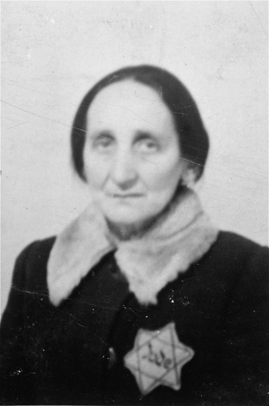 "<p>Portrait of an elderly Jewish woman wearing a <a href=""/narrative/11750"">Jewish badge</a> in the Olkusz ghetto. Olkusz , Poland, 1941.</p>"