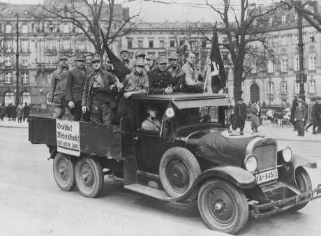 "<p>Scene during the<a href=""/narrative/102""> boycott of Jewish businesses</a>. A sign on truck carrying Storm Troopers (SA) urges ""Germans! Defend yourselves. Don't buy from Jews."" <a href=""/narrative/5908"">Berlin</a>, Germany, April 1, 1933.</p>"