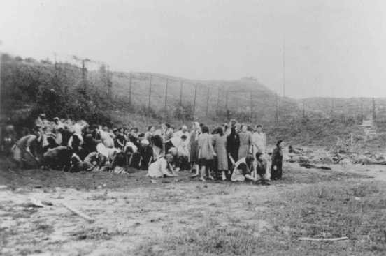 <p>Jewish women with bodies of executed men outside the Seventh Fort. Kovno, Lithuania, date uncertain.</p>