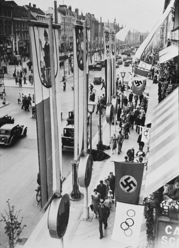 "<p>German (swastika) and Olympic flags fly in Berlin during the <a href=""/narrative/7139/en"">Olympic Games</a>. Berlin, Germany, August 1936.</p>"