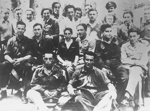 "<p>Group of <a href=""/narrative/5666"">Jewish parachutist</a>s under British command including Haviva Reik (center), who was sent into Slovakia. Palestine, wartime.</p>"