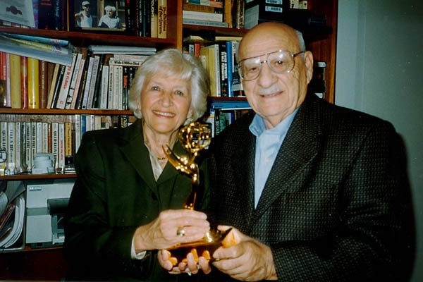 <p>Aron and Lisa with the Emmy they won for their 1997 documentary, A Journey of Remembrance. Photograph taken in Northbrook, Illinois, 1998.</p>