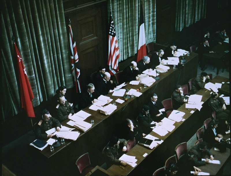 <p>The International Military Tribunal was a court convened jointly by the victorious Allied governments. Here the Soviet, British, American, and French flags hang behind the judges' bench.</p>
