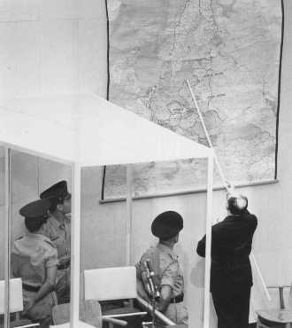 Defendant Adolf Eichmann identifies the city of Danzig (Gdansk) on a map during his trial in Jerusalem. [LCID: 65288]