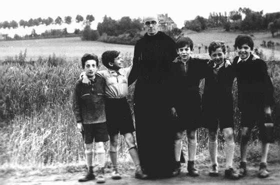 "<p><a href=""/narrative/11649/en"">Father Bruno</a> with Jewish children he hid from the Germans. Yad Vashem recognized Father Bruno as ""Righteous Among the Nations."" Belgium, wartime.</p>"