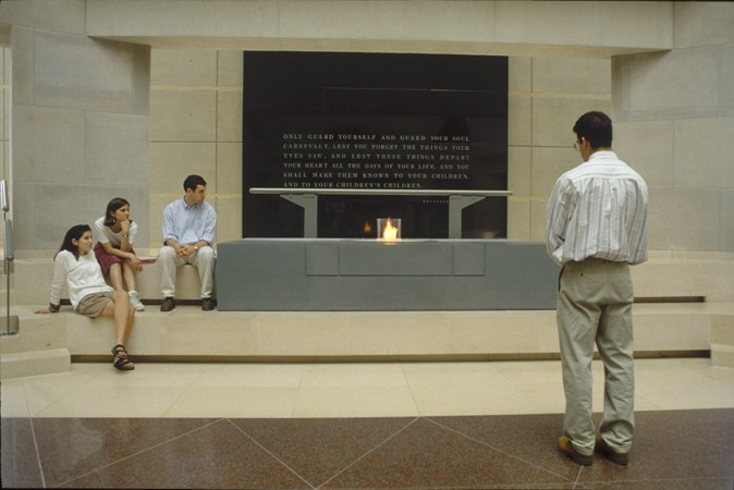Visitors view the eternal flame in the Hall of Remembrance at the United States Holocaust Memorial Museum. [LCID: n0177501]