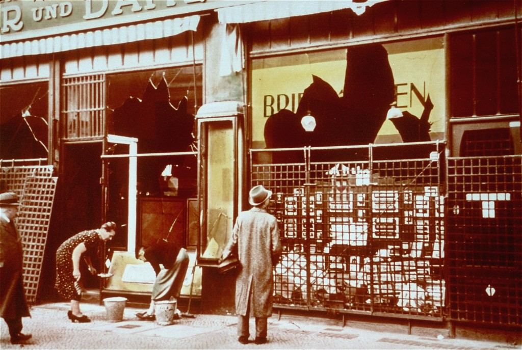 "Storefronts of Jewish-owned businesses damaged during the Kristallnacht (""Night of Broken Glass"") pogrom. [LCID: 4315]"