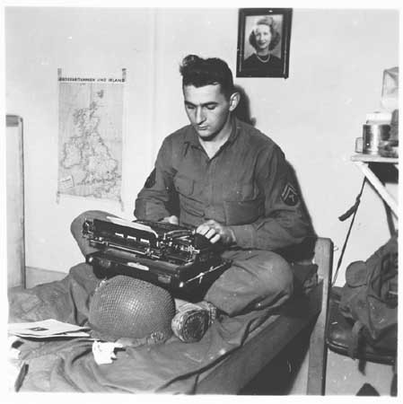 US Army Signal Corps photographer J Malan Heslop types photo captions. [LCID: 62744]