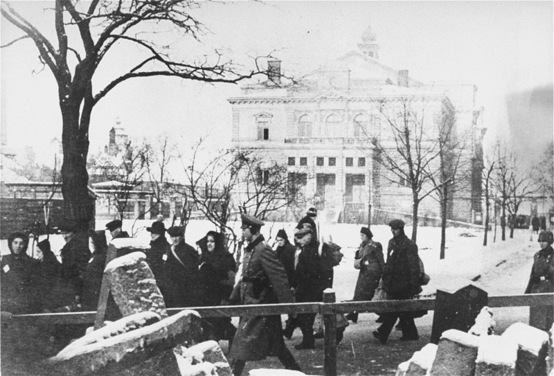 "<p>Deportation of Jews from Plzen (Pilsen) to <a href=""/narrative/5386"">Theresienstadt</a>. The building in the background is the town theater. Czechoslovakia, 1942.</p>"