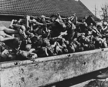 A wagon is piled high with the bodies of former prisoners in the newly liberated Buchenwald concentration camp. [LCID: 74604]