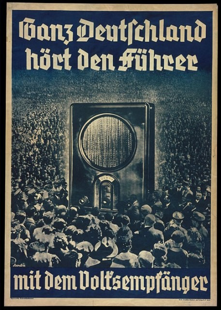 "1936 poster:  ""All of Germany Listens to the Führer with the People's Radio."" [LCID: p533a]"