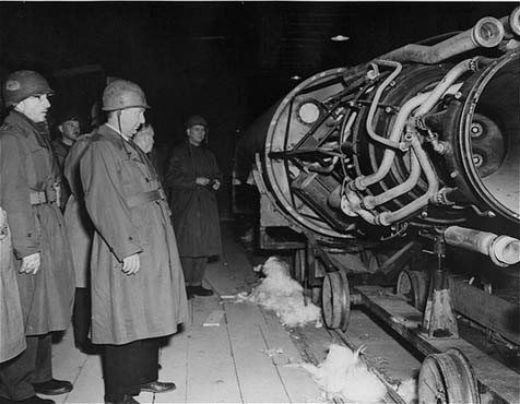 Members of a US congressional committee investigating German atrocities view a V-2 rocket on the assembly line of an underground ... [LCID: 91683]