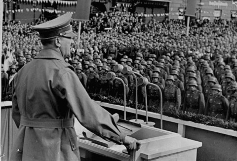 <p>Hitler addresses German troops at the market square in Eger, during the German occupation of Czechoslovakia's Sudetenland region. October 3, 1938.</p>
