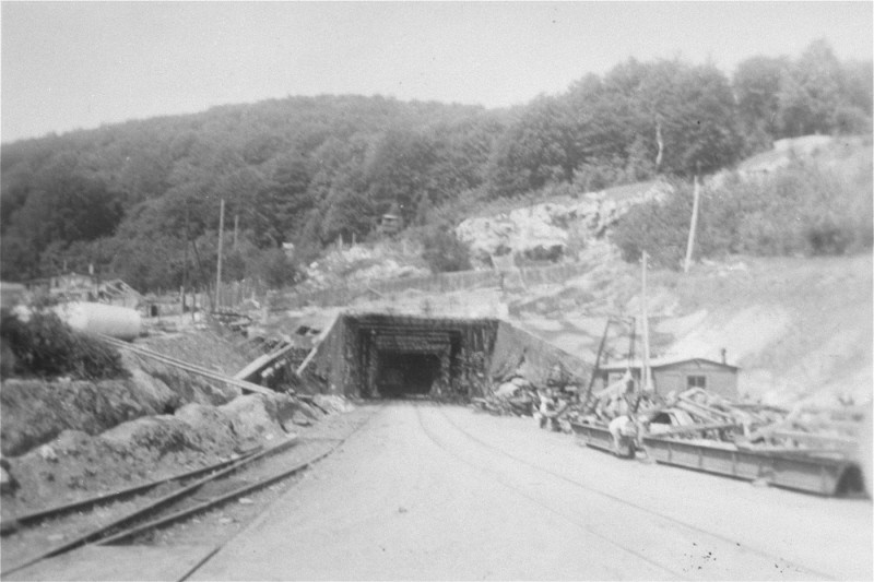 View of a tunnel entrance to the rocket factory at the Dora-Mittelbau concentration camp, near Nordhausen. [LCID: 01276]