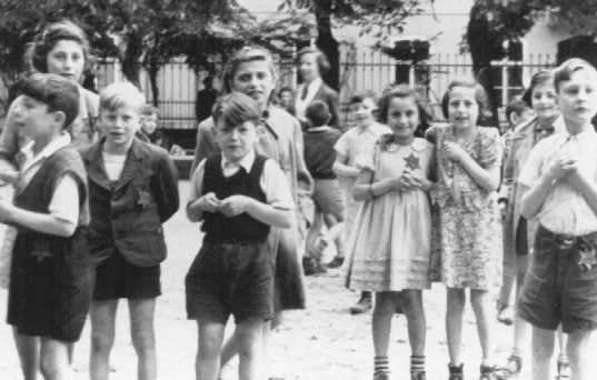 A photograph of Jewish children in the Theresienstadt ghetto taken during an inspection by the International Red Cross. [LCID: 73346b]