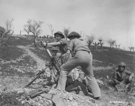 <p>The 3-inch-mortar crew of the British army's Jewish Brigade Group, composed of volunteers from Palestine, fires on German positions during the final Allied offensive in Italy, March 30, 1945.</p>