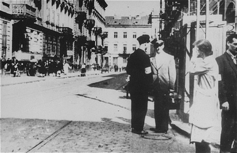 <p>Street scene following the German occupation of the city of Lvov. Lvov, Poland, June 1941.</p>