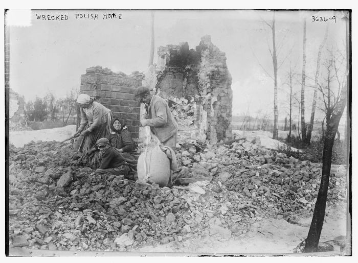 """<p>A man, women and a child sort through the rubble of a Polish home destroyed during <a href=""""/narrative/28"""">World War I</a>. Photograph taken ca. October 18, 1915.</p>"""