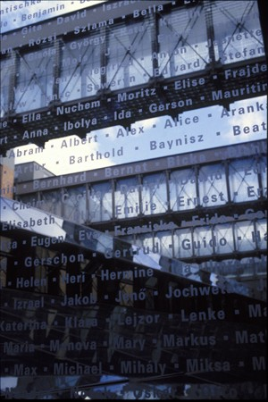 Detail of an interior bridge at the United States Holocaust Memorial Museum with the names of victims etched in glass. [LCID: n02192]