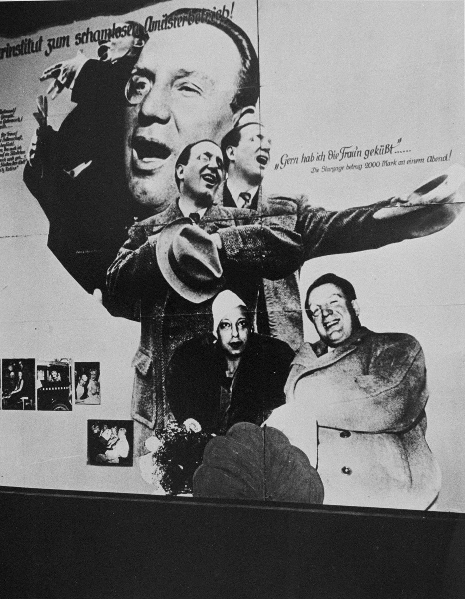 "<p>Display from ""<a href=""/narrative/11815/en"">Der ewige Jude</a>"" (The Eternal Jew), a Nazi antisemitic exhibit which claimed that Jews heavily dominated the German performing arts. A phrase at the top of the display states ""Shameless Entertainment."" Berlin, Germany, November 11, 1938.</p>"