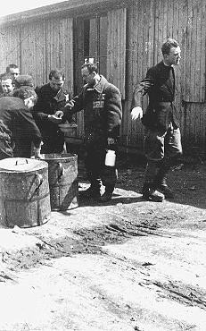 Prisoners receive meager food allocations at the Plaszow camp. [LCID: 03409]