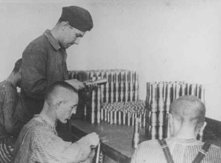 <p>Prisoners work in an armaments factory. Dachau concentration camp, Germany, between 1940 and 1945.</p>