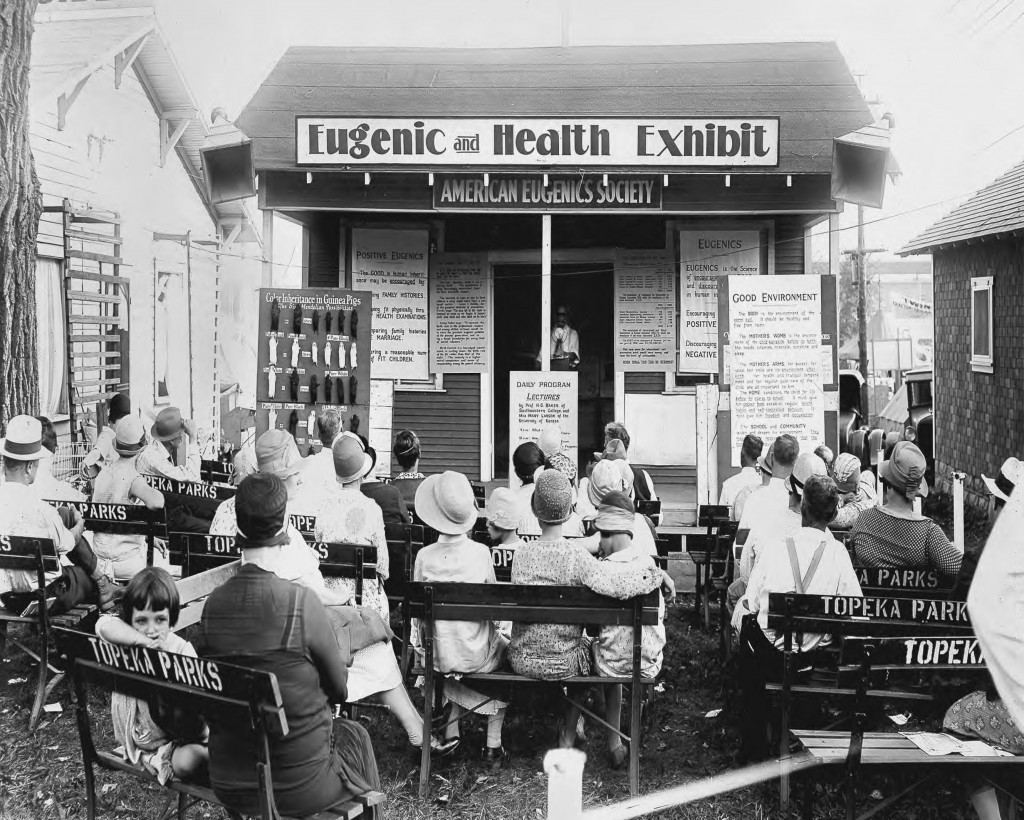 """<p>The American Eugenics Society displays an exhibit on health and <a href=""""/narrative/52889"""">eugenics</a> at the Kansas Free Fair in 1929.</p>"""